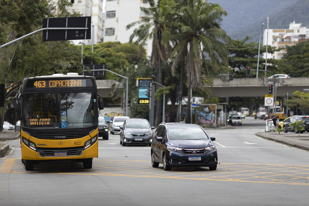RIO DE JANEIRO, BRAZIL - May 27, 2020: Rio de Janeiro, Brazil - May 27, 2020: Local bus from Jardim Botanico to Copacabana passing by with palm trees in the background.